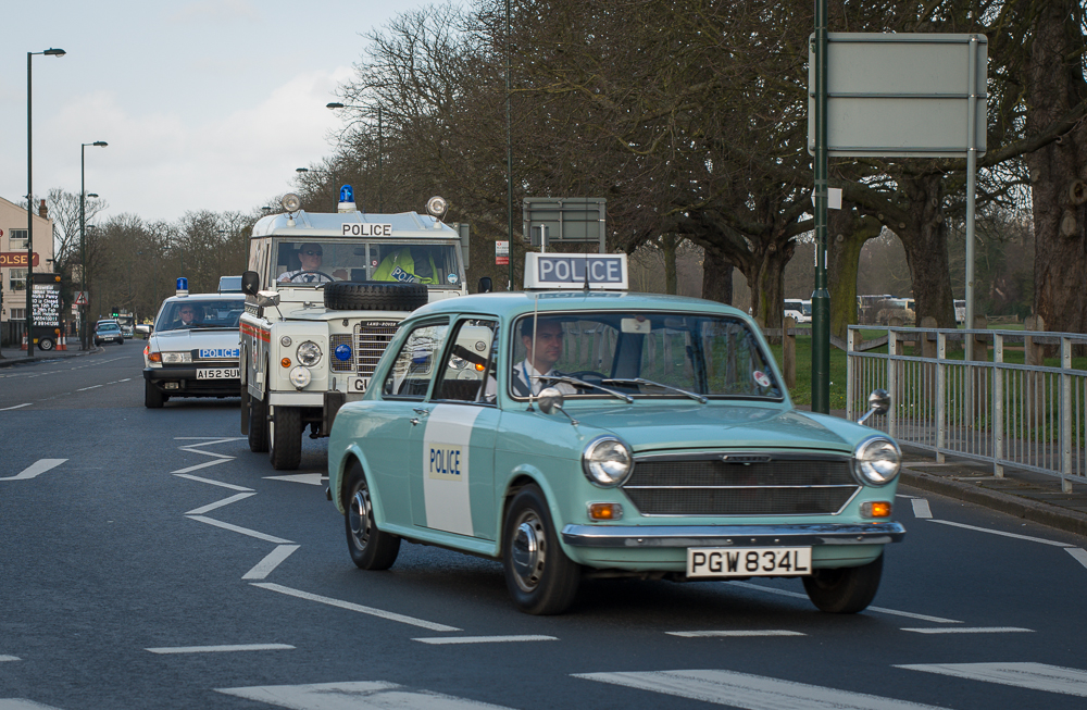 Vintage Police cars leaving Hampton