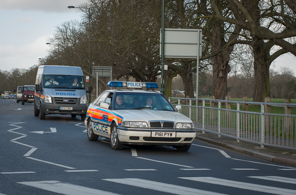 Vintage Police cars leaving Hampton