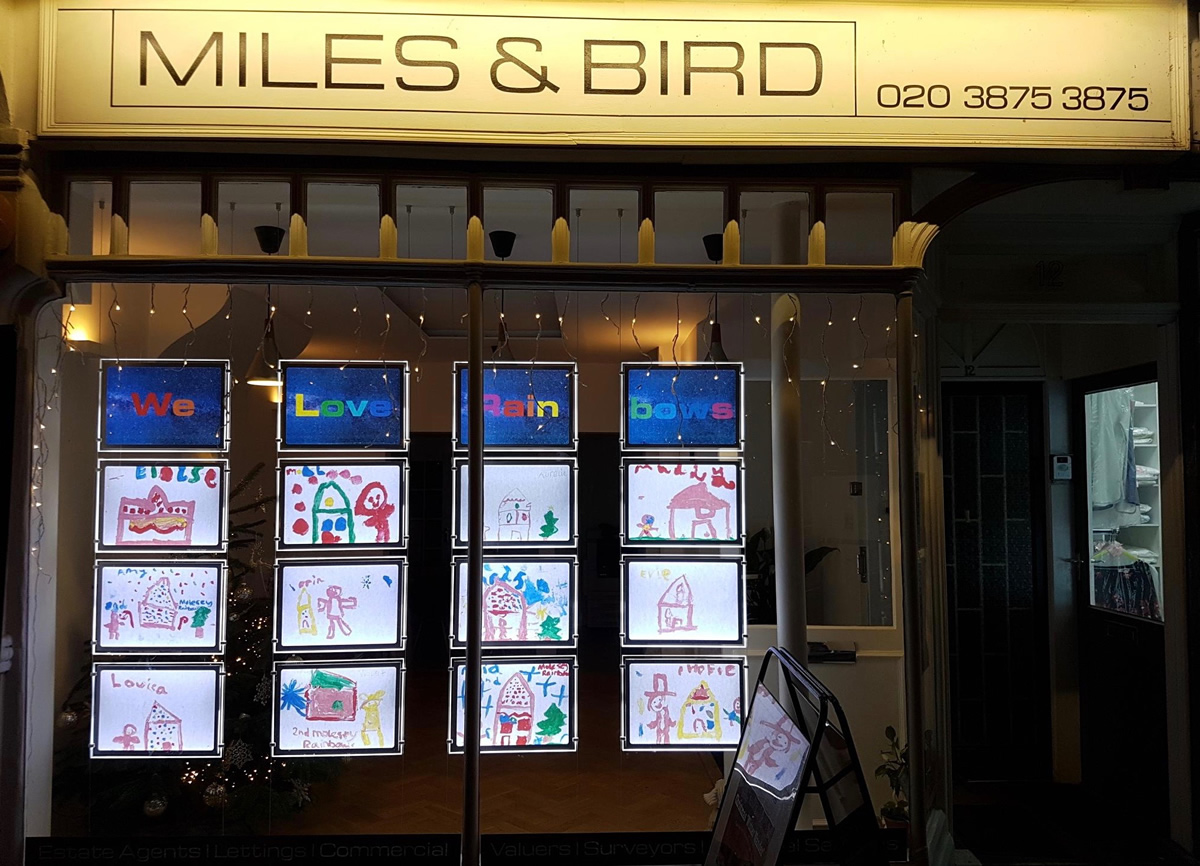 Miles Bird estate agent Rainbows gingerbread house window display Bridge Road Winter Wander